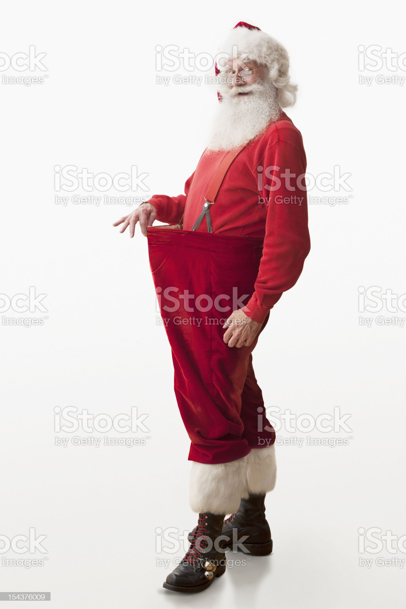 Santa claus showing his weight loss royalty-free stock photo