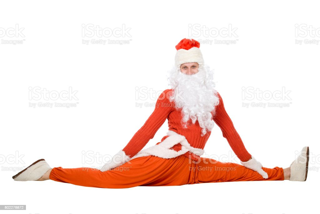 Santa Claus sits on a splits stock photo