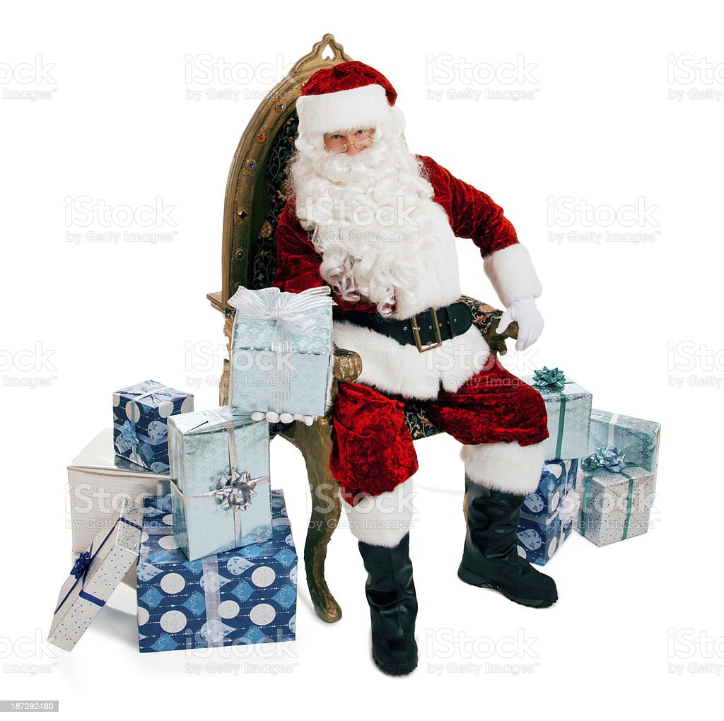 Santa Claus Sitting in a Chair with Presents stock photo