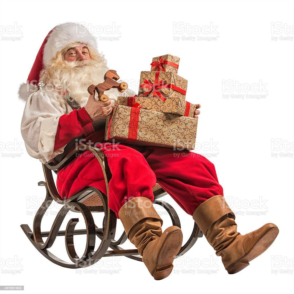 Santa Claus sitting in rocking chair stock photo