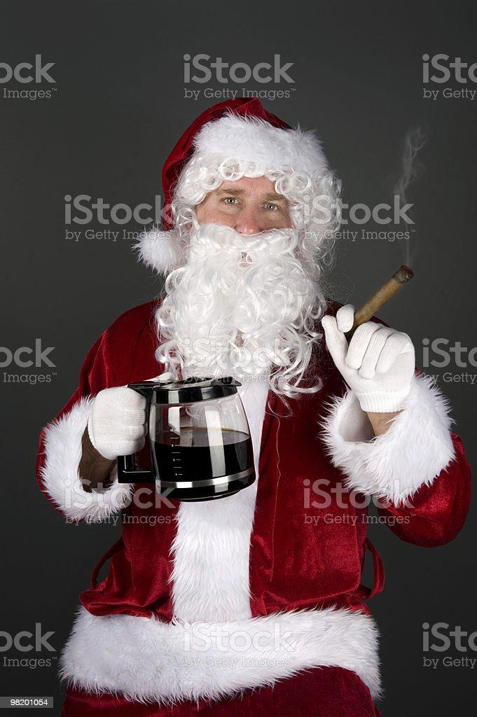 Santa Claus smoking a cigar and drinking coffee stock photo