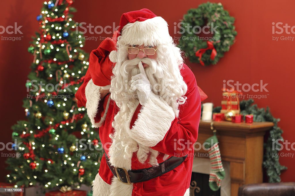 Santa Claus sneaking into home royalty-free stock photo