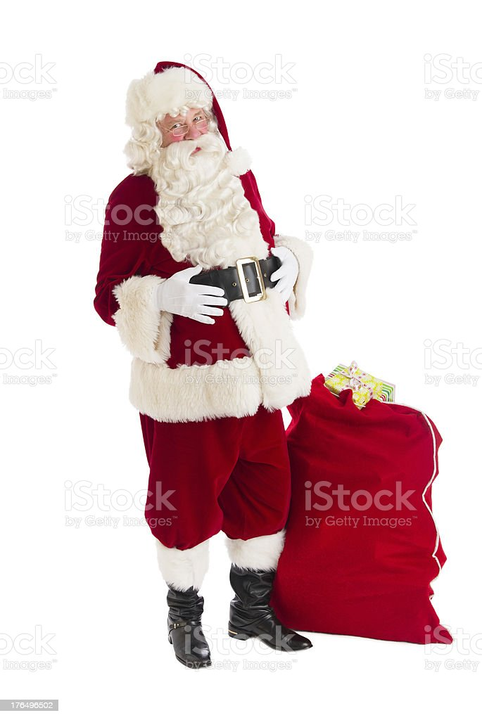 Santa Claus Standing With Bag Full Of Gifts royalty-free stock photo