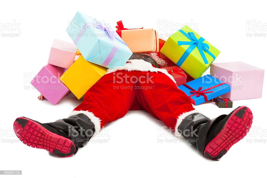 santa claus tired to lie on floor with gift boxes stock photo