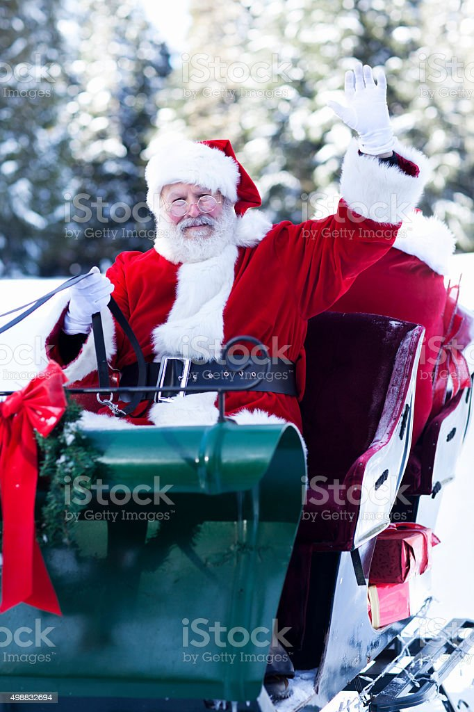 Santa Claus Waving in His Sleigh stock photo