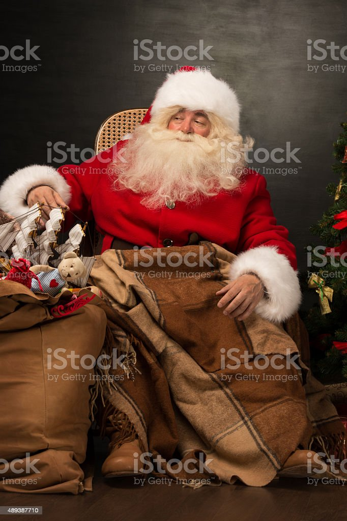 Santa Claus with a huge bag full of Christmas presents stock photo