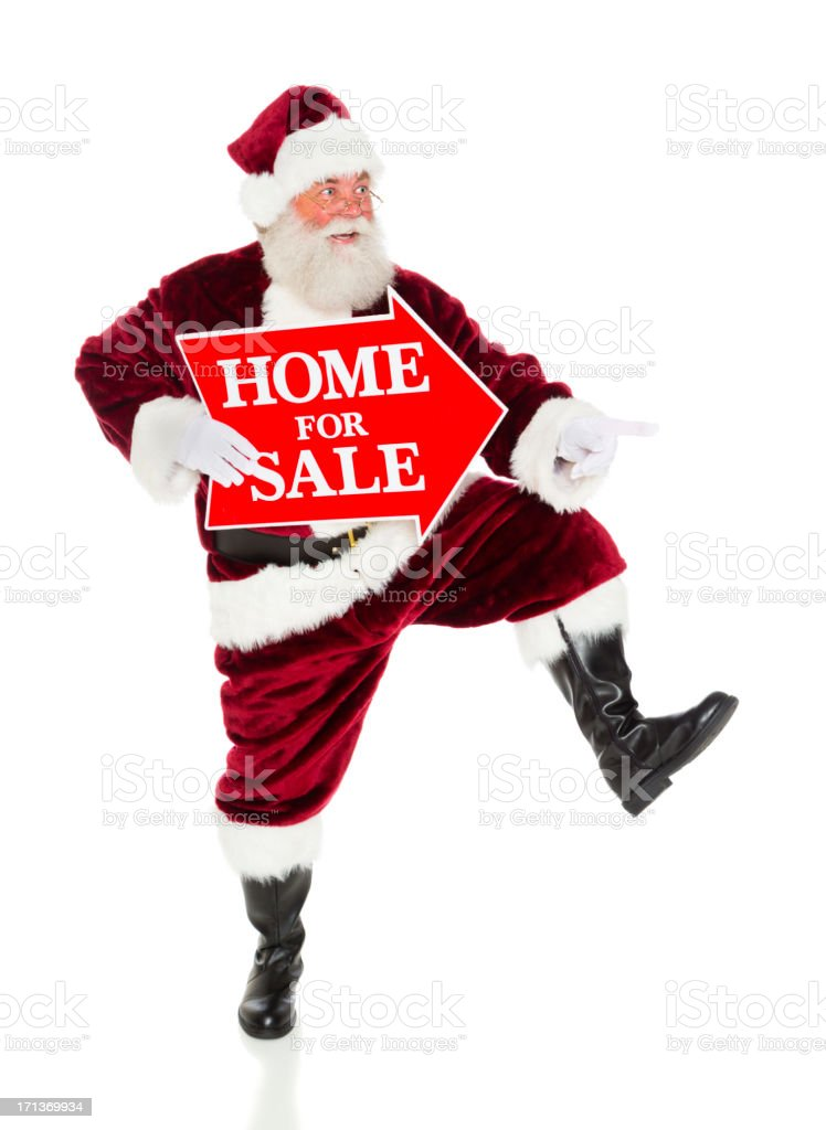 Santa Claus with a Real Estate Sign royalty-free stock photo