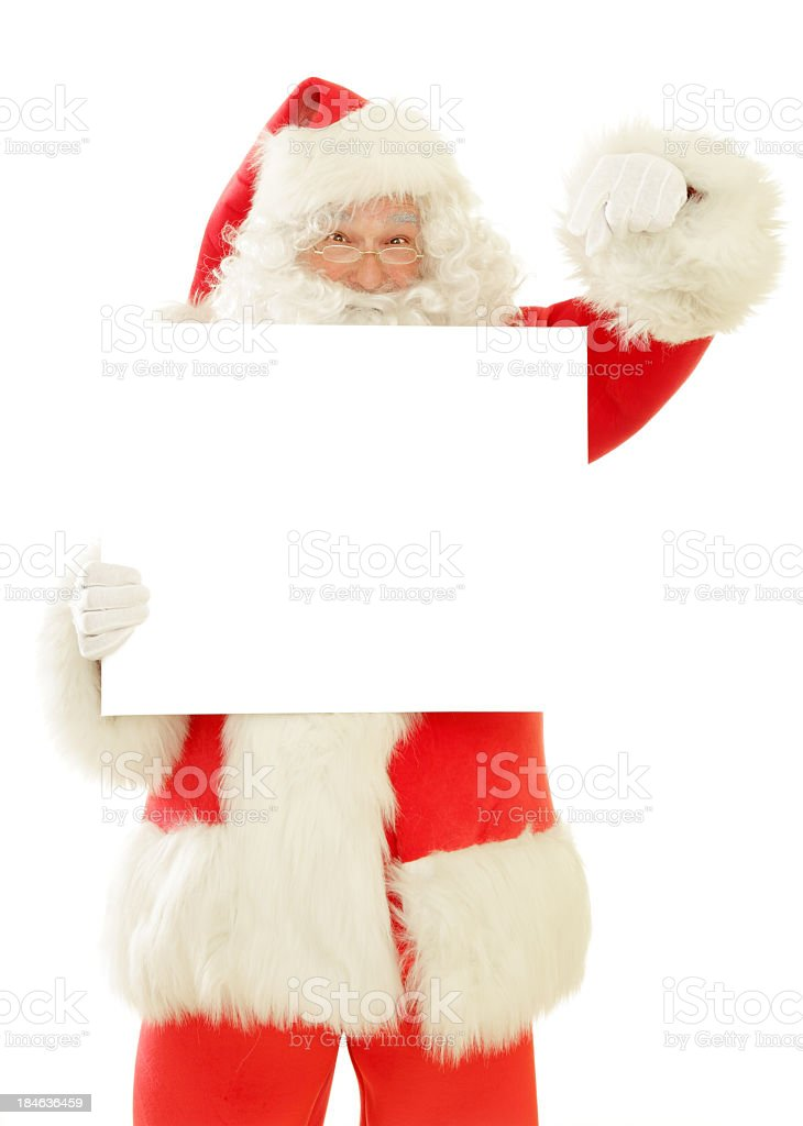 Santa Claus with Blank Sign, Pointing Down royalty-free stock photo