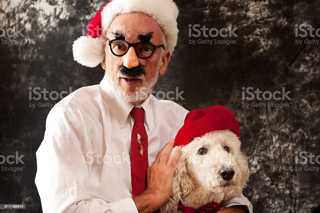 Santa Claus with Groucho Glasses and His Best Friend stock photo