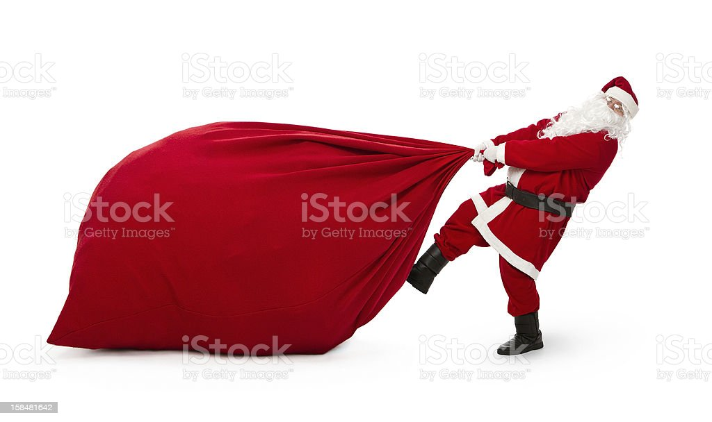 Santa Claus with huge bag of presents stock photo