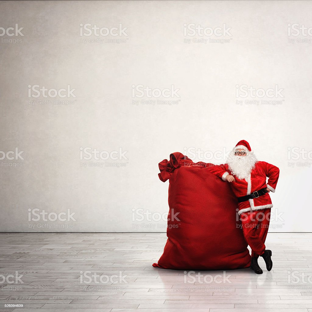 Santa Claus with large red sack stock photo