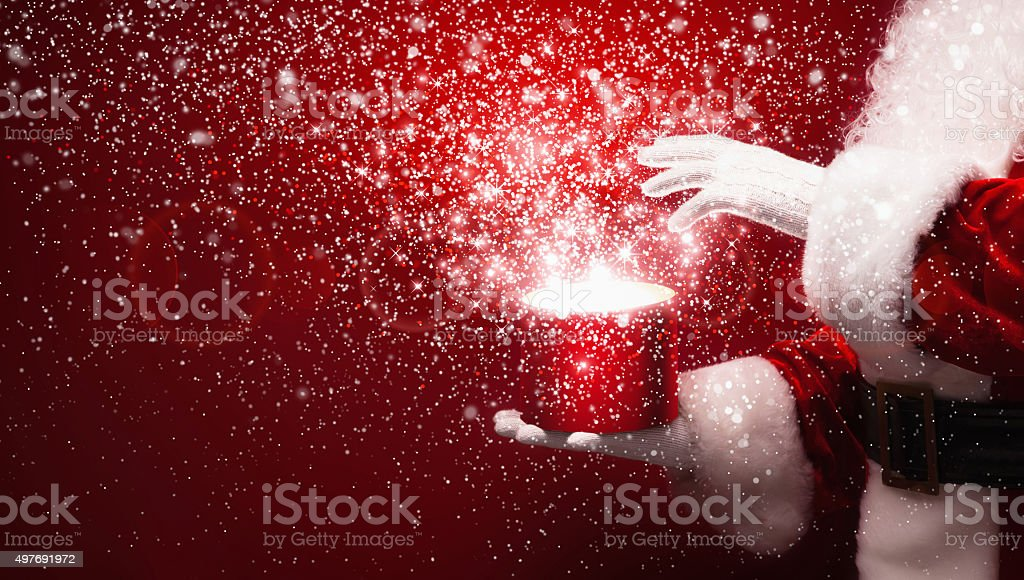Santa Claus with magic box stock photo