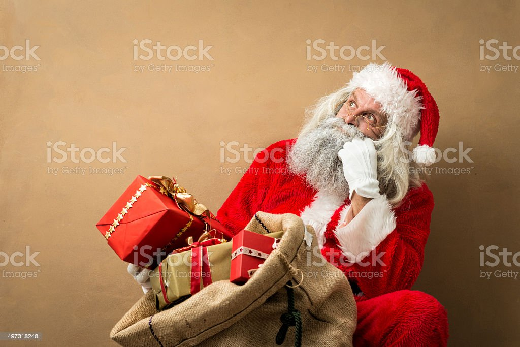 santa claus with many gifts in his bag stock photo