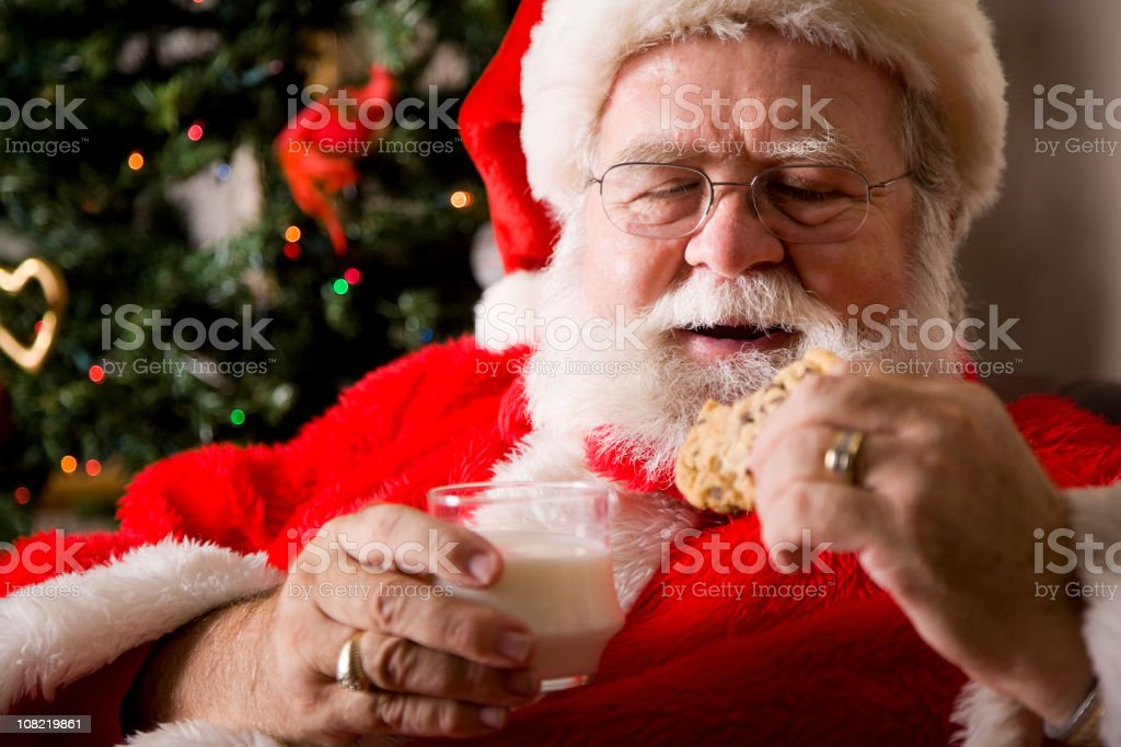 Santa Claus with Milk and Cookies royalty-free stock photo