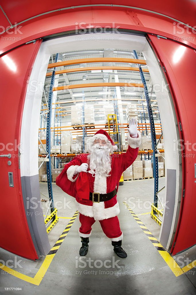 Santa Claus with red sack  in greeting pose royalty-free stock photo