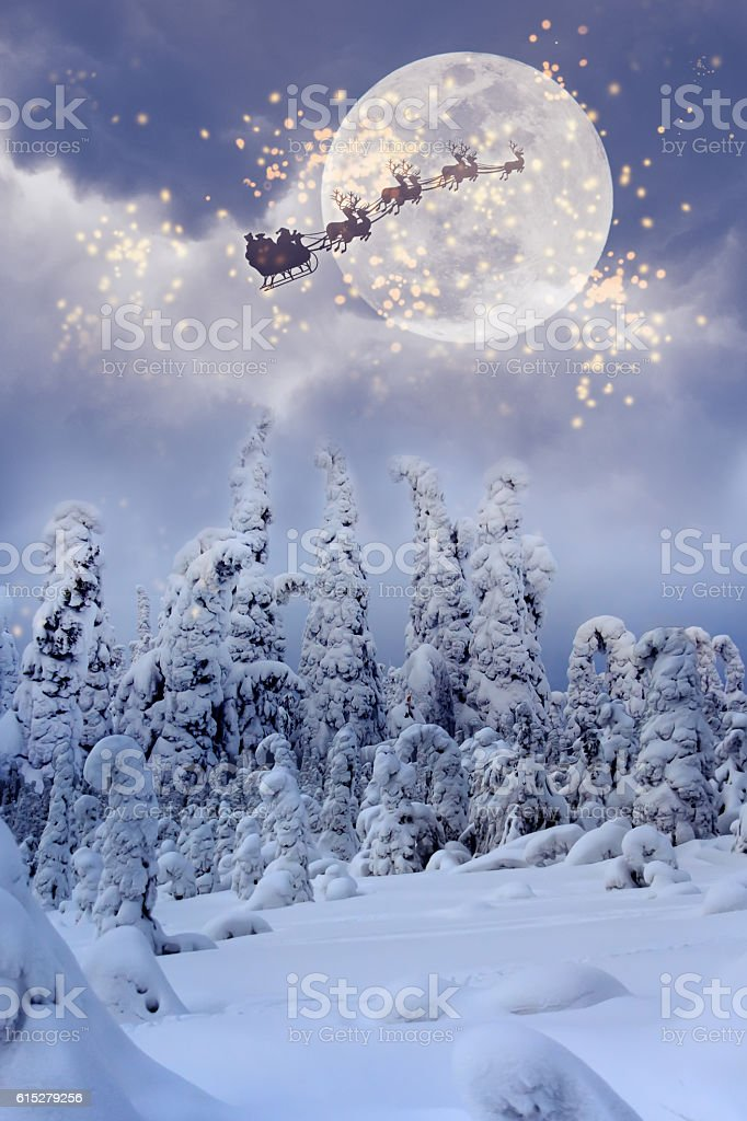Santa Claus with reindeer flying through the sky. stock photo