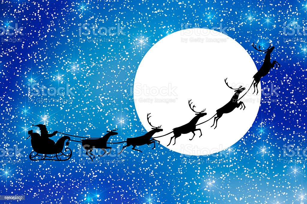 Santa Claus with reindeer sleigh flying in the blue sky stock photo