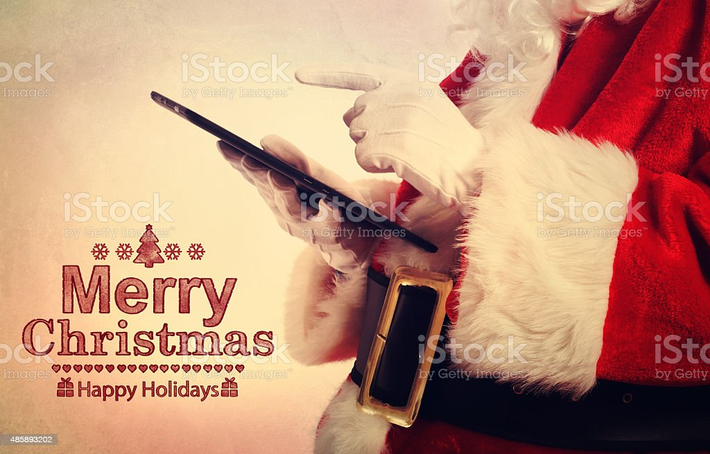 Santa Claus with tablet stock photo