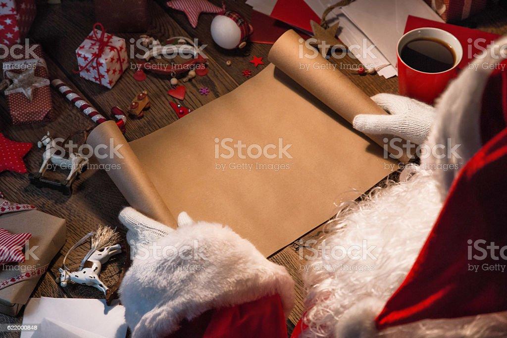 Santa Claus with wish list stock photo