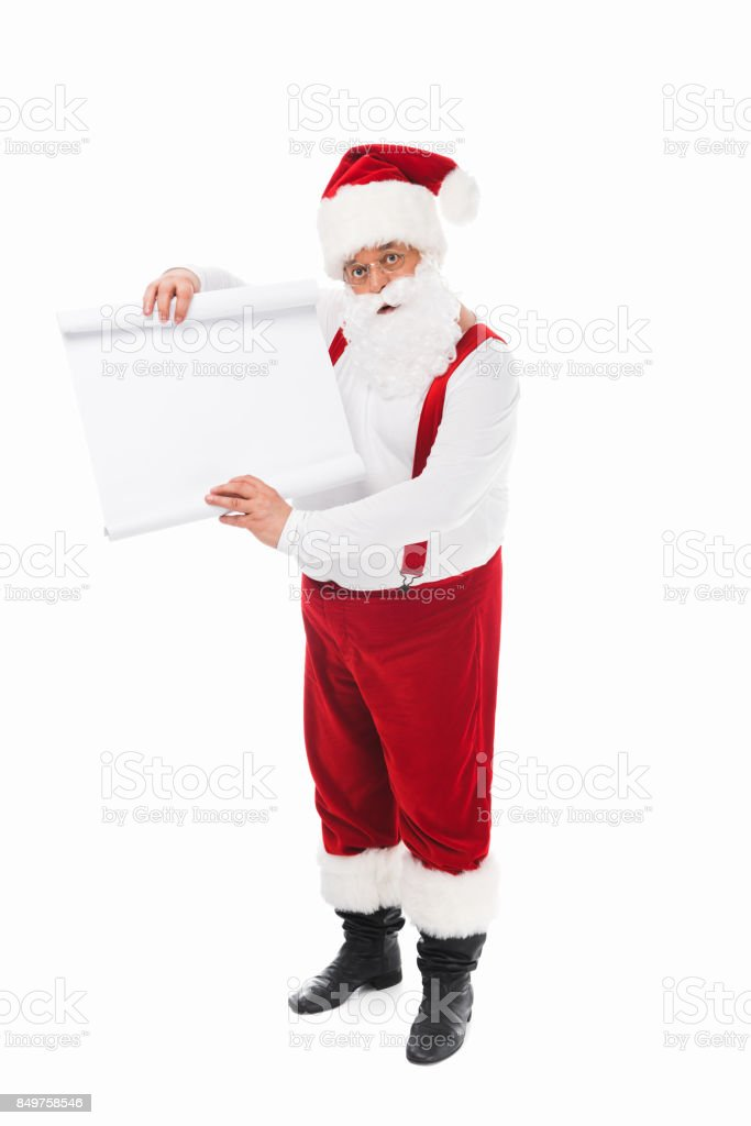 santa claus with wish list stock photo