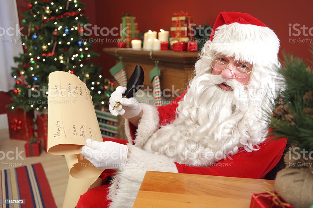 Santa Claus writing names on list royalty-free stock photo