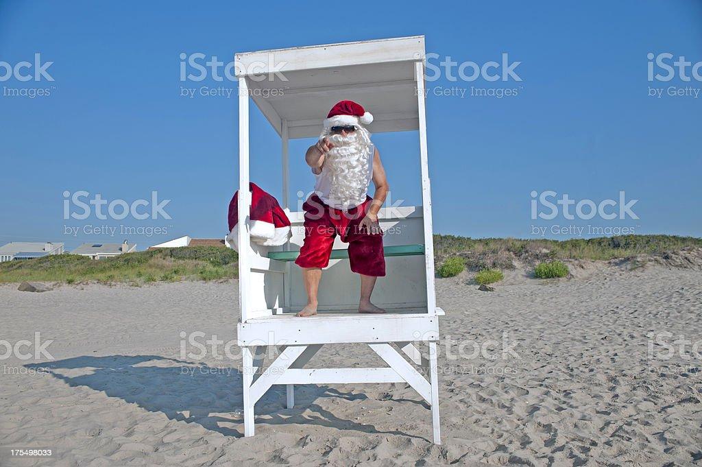 Santa Clause as a lifeguard on the beach stock photo