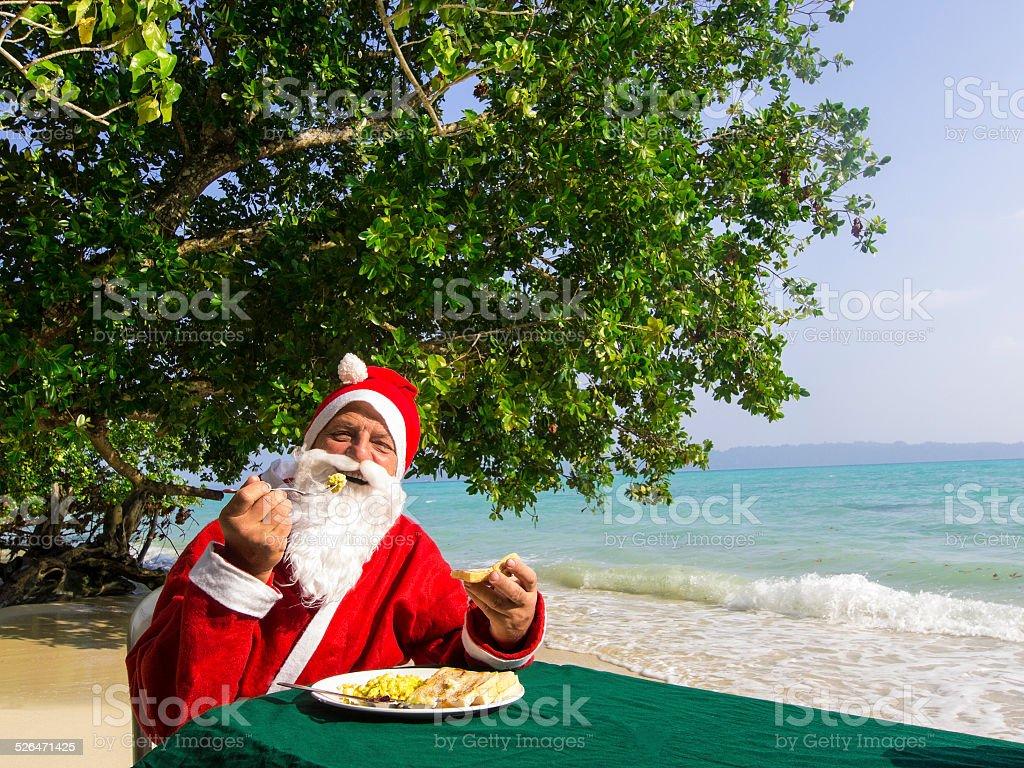 Santa Cloaus  having Breakfast at Vijaynagar stock photo