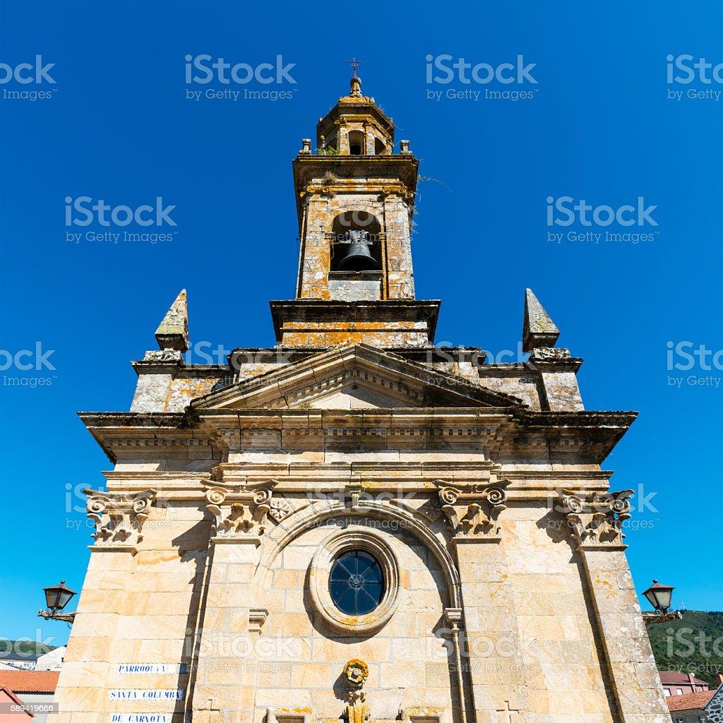 Santa Columba de Carnota against a blue sky stock photo