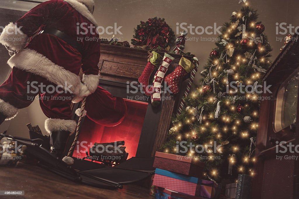 Santa Coming Down Chimney-Vintage stock photo