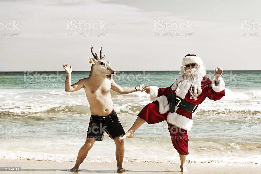 Santa dancing with his friend stock photo