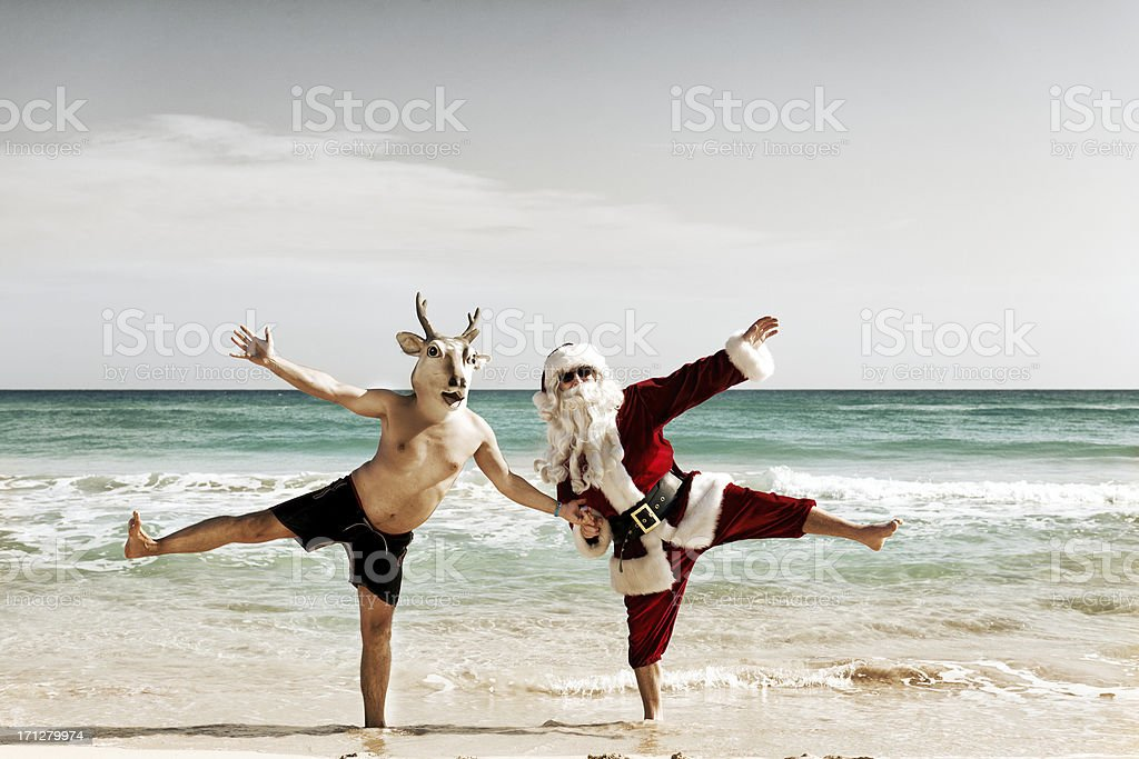 Santa dancing with reindeer stock photo