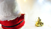 santa doll and four gold balls decoration object