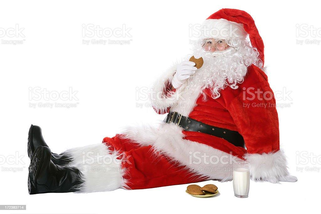 Santa eating cookies royalty-free stock photo