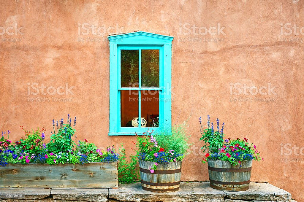 Santa Fe Blue Window on Stucco Wall with Flowers stock photo
