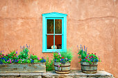 Santa Fe Blue Window on Stucco Wall with Flowers