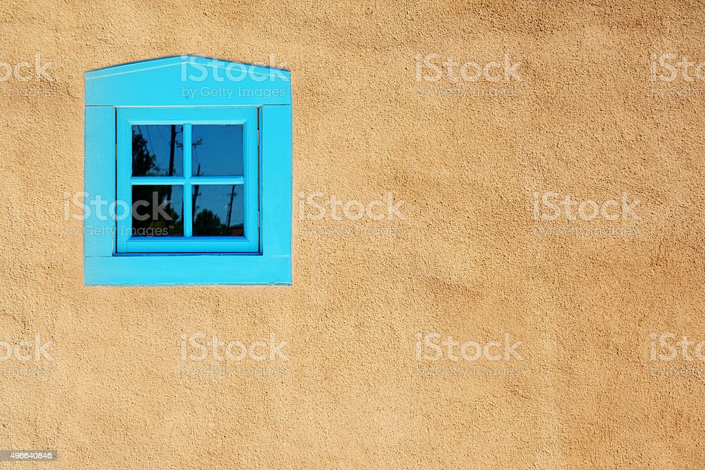 Santa Fe Blue Window on Stucco Wall with Shutters stock photo