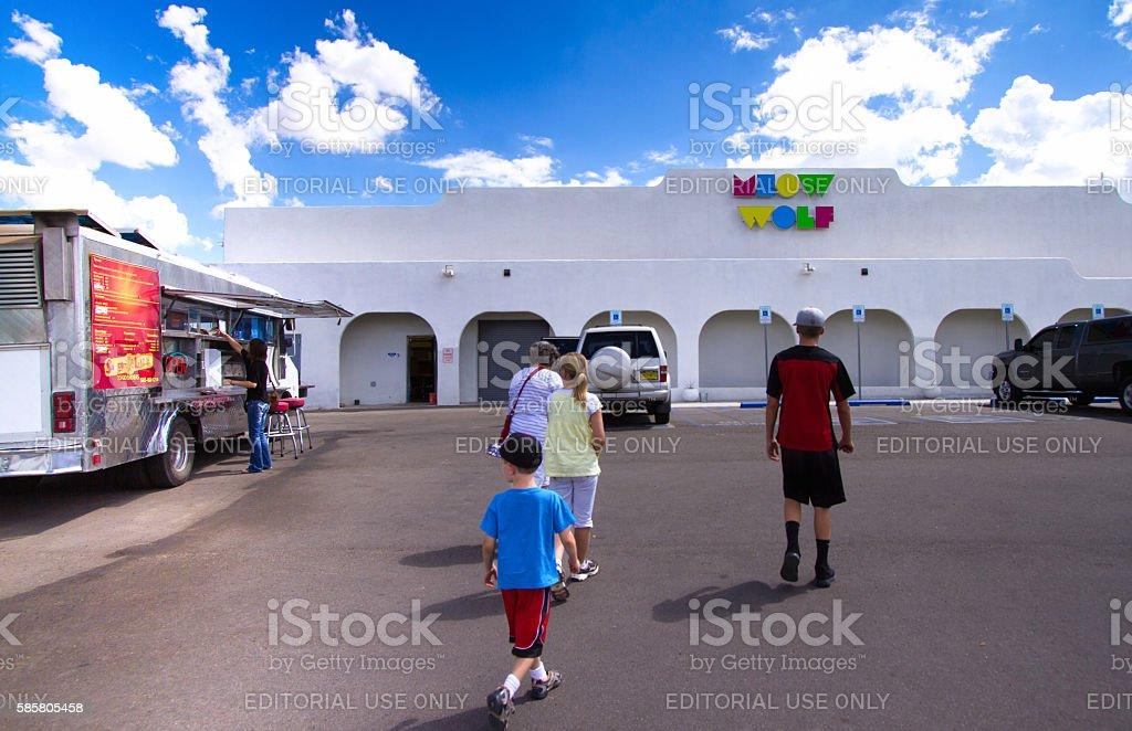 Santa Fe: Family Approaching 'Meow Wolf,' Multimedia Arts Funhouse stock photo