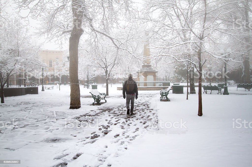 Santa Fe in Fresh Snow: Foggy Plaza with Lone Pedestrian stock photo