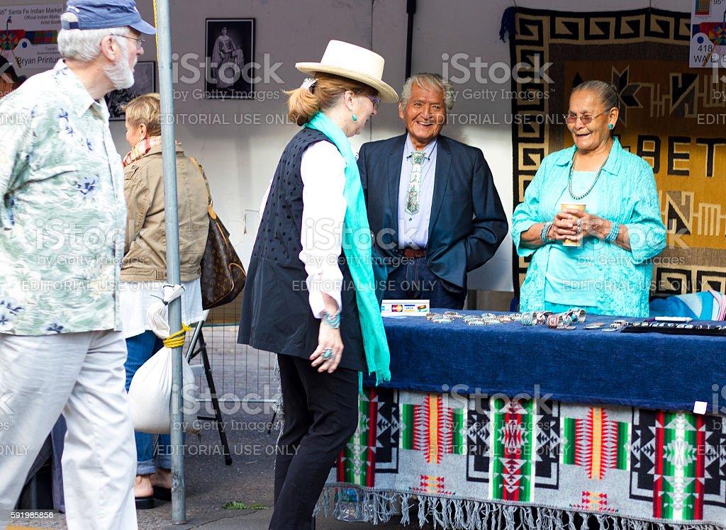 2016 Santa Fe Indian Market: Navajo-Dine Jeweler with Work stock photo