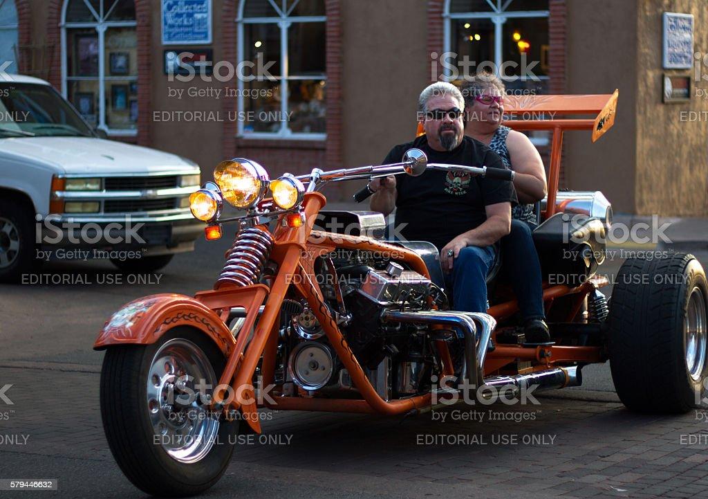 Santa Fe, NM: Baby Boomer Couple on Fancy Orange Trike stock photo