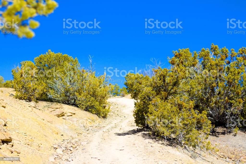 Santa Fe, NM: Footpath in the High Desert, Blue Sky stock photo
