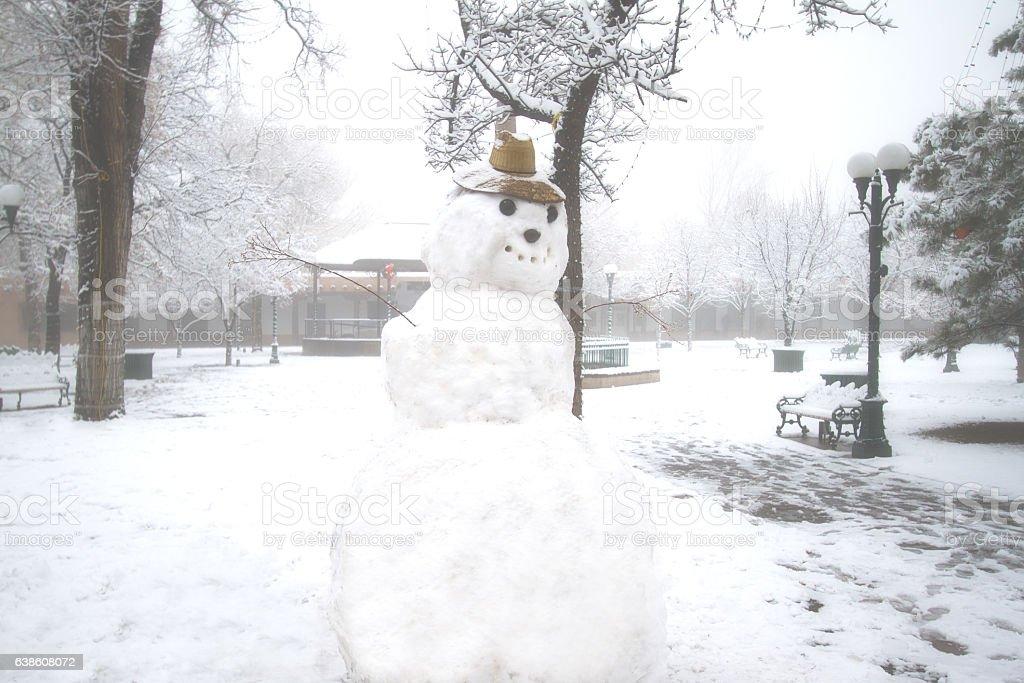 Santa Fe, NM: Santa Fe Plaza with Fog, Snow, Snowman stock photo