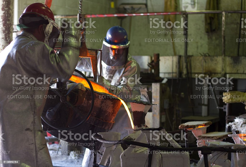 Santa Fe, NM: Workers Pouring Bronze at Shidoni Foundry stock photo