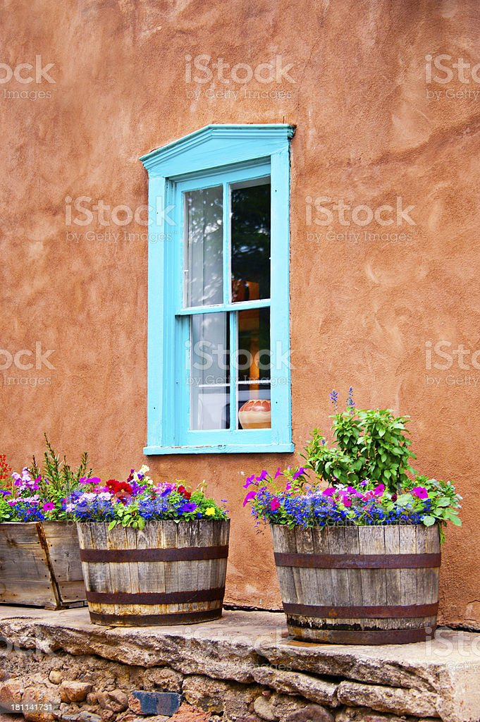 Santa Fe Old Adobe House with Stucco Wall and Flowers royalty-free stock photo