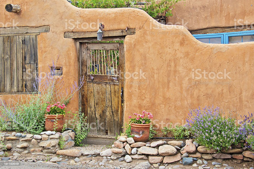 Santa Fe Old Adobe House with Stucco Wall and Flowers stock photo
