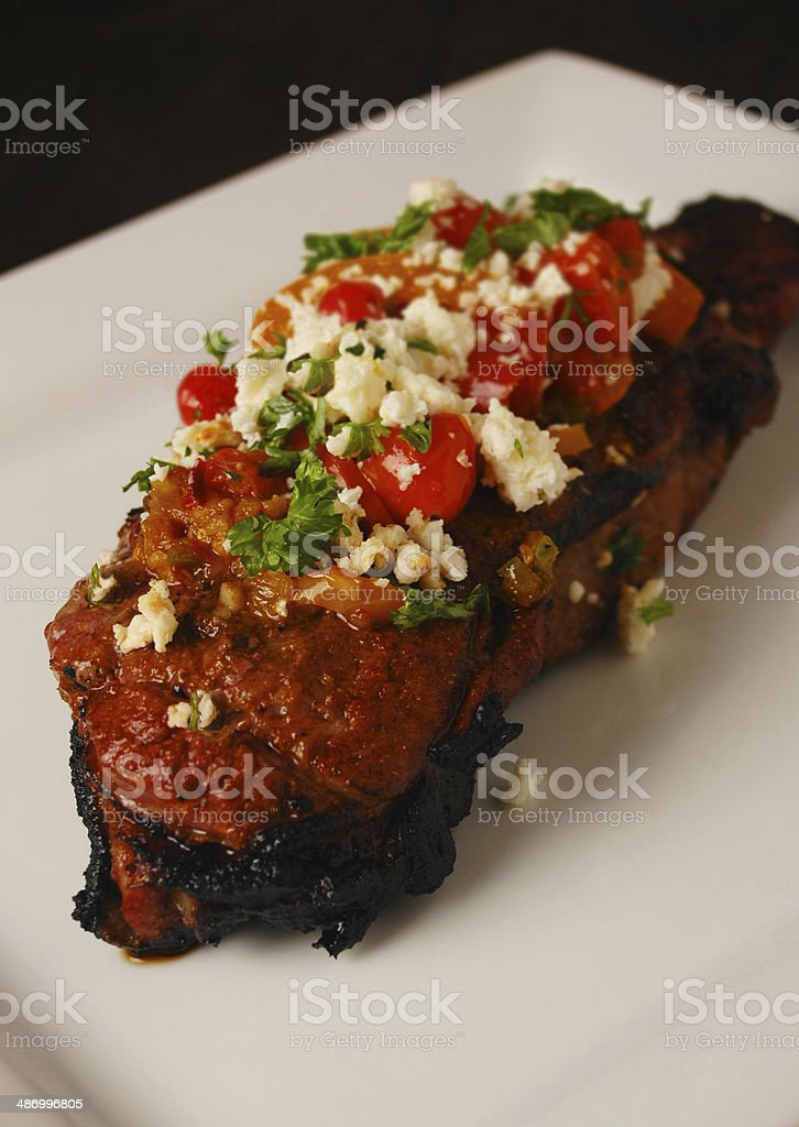 Santa Fe Southwest Steak with Tomato and Cotija Toppings royalty-free stock photo