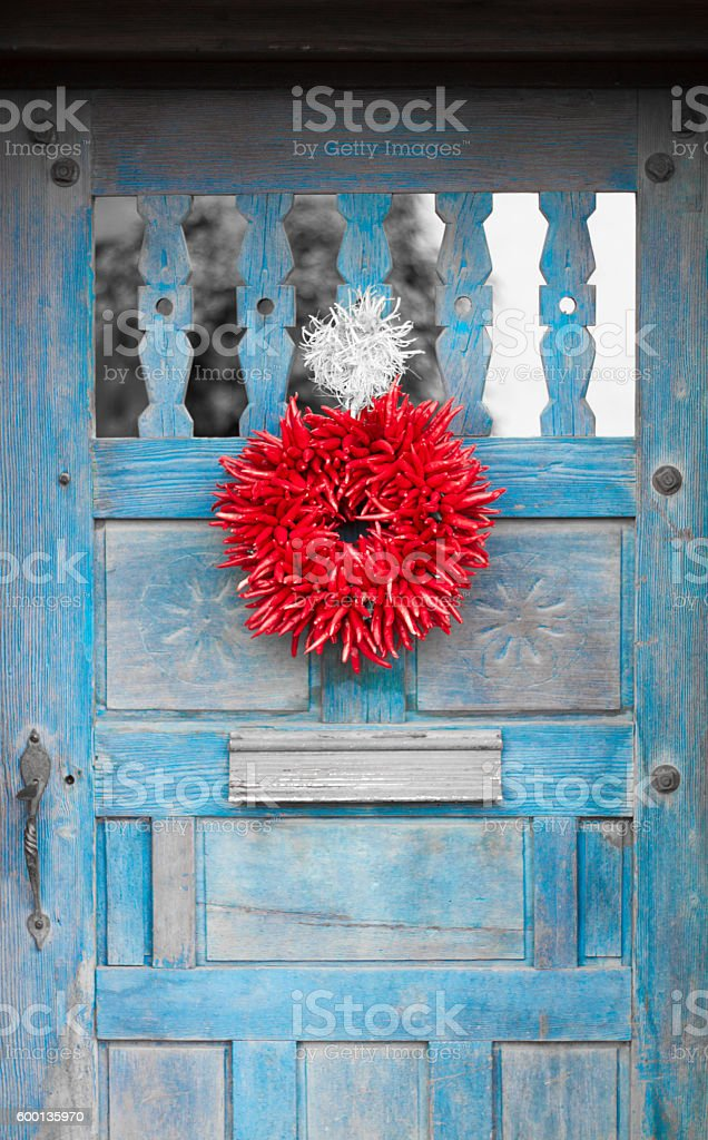 Santa Fe Style: Chili Pepper Ristra Wreath, Vintage Blue Door stock photo