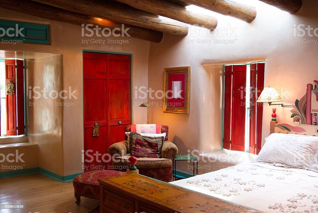 Santa Fe Style: Colorful Bedroom, Viga Beams, Thick Adobe Walls stock photo