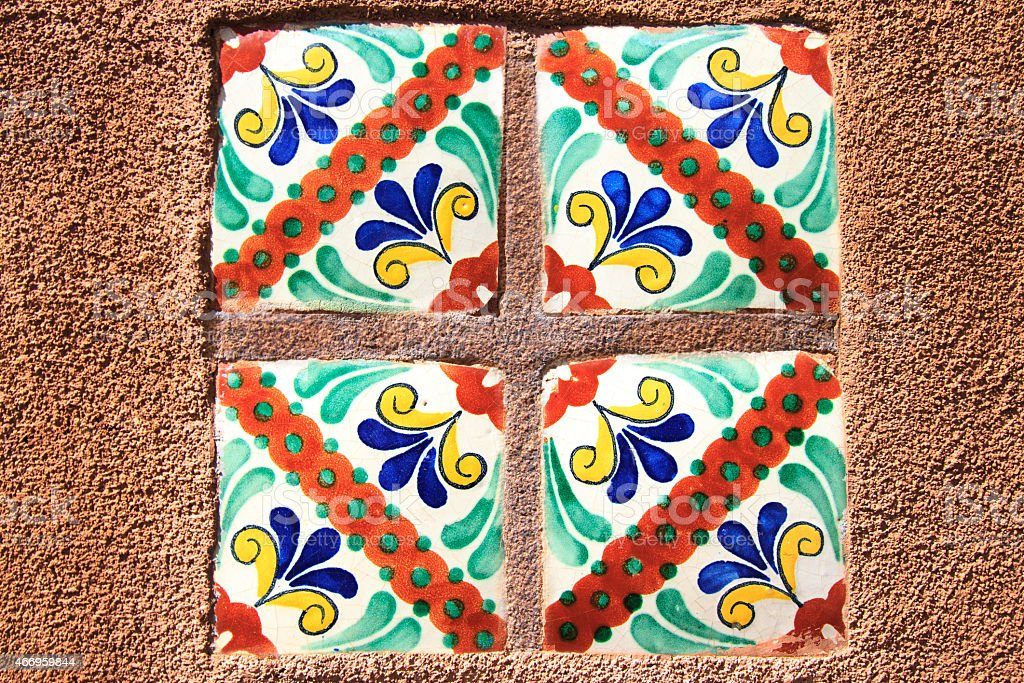 Santa Fe Style: Colorful Mexican Tiles in Adobe Wall stock photo