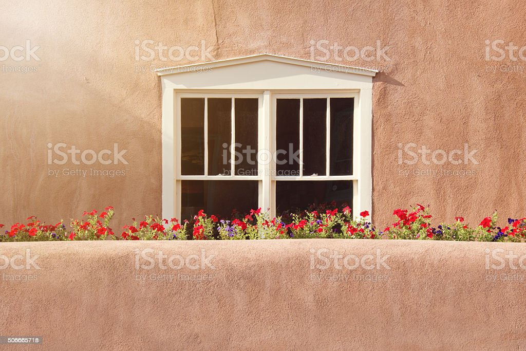 Santa Fe Style Old Window, Stucco Wall and Flowers stock photo